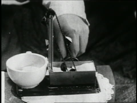 B/W 1923 close up hand of man pulling chain releasing sugar into coffee cup / short