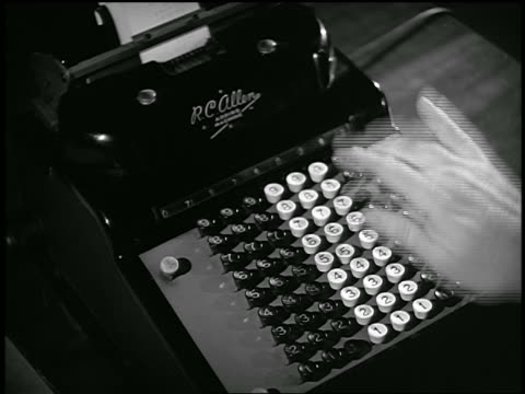 b/w 1953 close up hand of man using adding machine / industrial - 電卓点の映像素材/bロール