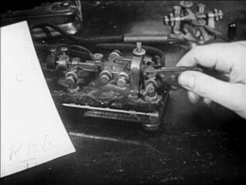 b/w 1929 close up hand of man using telegraph machine / newsreel - telegraph stock videos & royalty-free footage