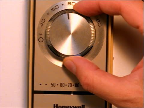 "close up hand of person turning knob of thermostat up to ""70"" - knob stock videos and b-roll footage"