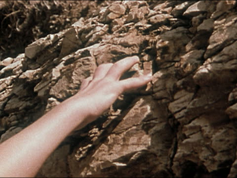 1978 close up hand of rock climber gripping crumbling rock face / losing grip - rock face stock videos & royalty-free footage
