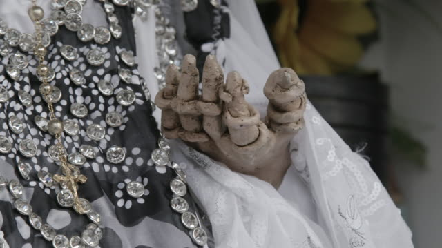 close up, hand of santa muerte statue - afterlife stock videos and b-roll footage