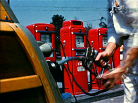 1950 close up hand of service man pumping gas / industrial - refuelling stock videos & royalty-free footage
