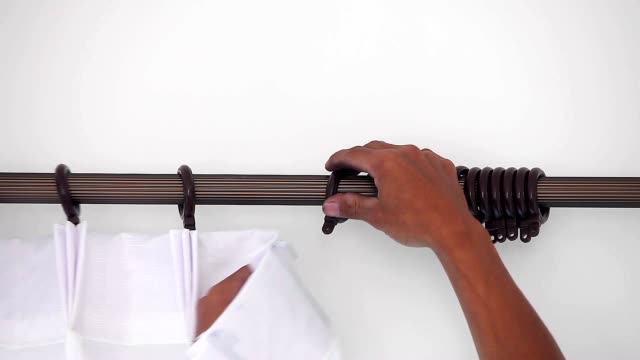 close up hand of technician installing red curtains over the windows in home. - hanging stock videos & royalty-free footage