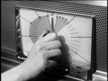 b/w 1959 close up hand of woman turning knob of early microwave oven - 1959 stock videos & royalty-free footage