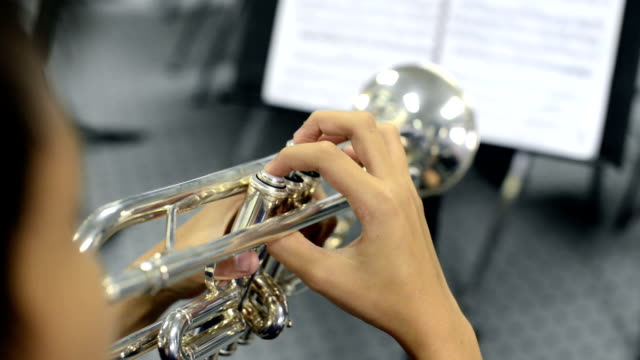 close up hand of young trumpet player - trumpet stock videos and b-roll footage