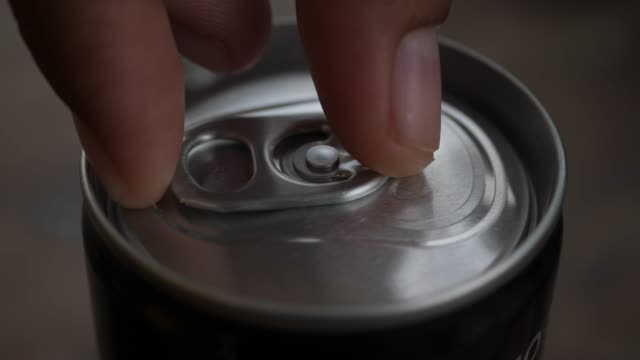 close up hand open softdrink can - tin stock videos & royalty-free footage