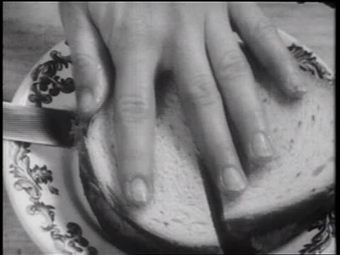 b/w 1939 close up hand placing sandwich on plate / documentary - documentary footage stock videos & royalty-free footage