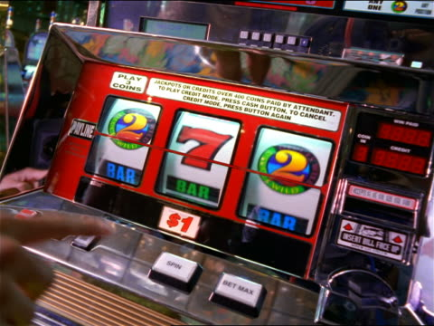 close up hand pressing buttons on spinning slot machine in casino - luck stock videos & royalty-free footage