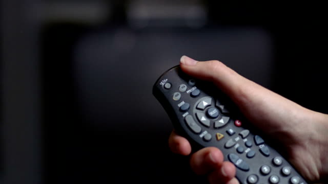 close up hand pressing power button on remote control / television turning on - television set stock videos & royalty-free footage