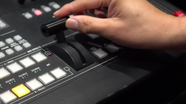 vídeos de stock e filmes b-roll de close up hand pulling on a video switcher, broadcast television. - editorial