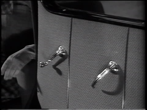 B/W 1937 close up hand shutting door of 1938 Ford V-8 car / commercial