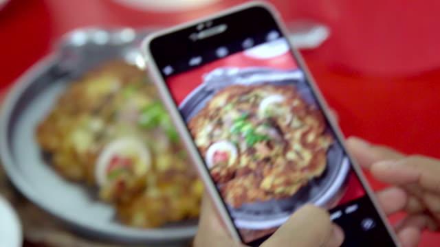 close up hand take photo thai street food. - thai food stock videos & royalty-free footage