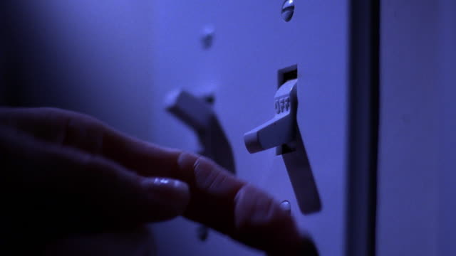"vídeos de stock, filmes e b-roll de close up hand turning light switch to ""on"" - interruptor de luz"