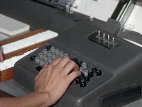 1962 close up hand typing on keypunch machine / nevada / audio - punch card stock videos & royalty-free footage