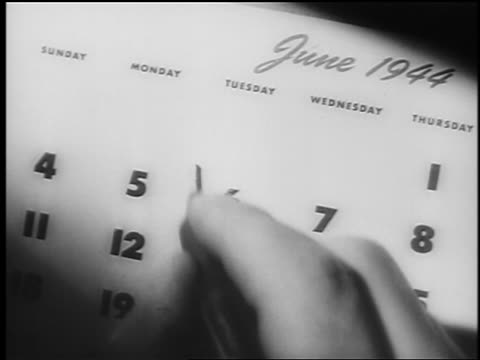 "close up hand uses pen to write ""v"" on june 6 on calendar / watch dissolves in / documentary - d day stock videos & royalty-free footage"