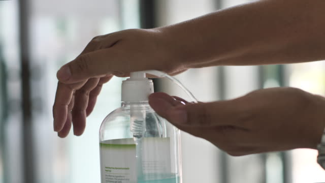 close up hand using a hand sanitizers - soap dispenser stock videos & royalty-free footage