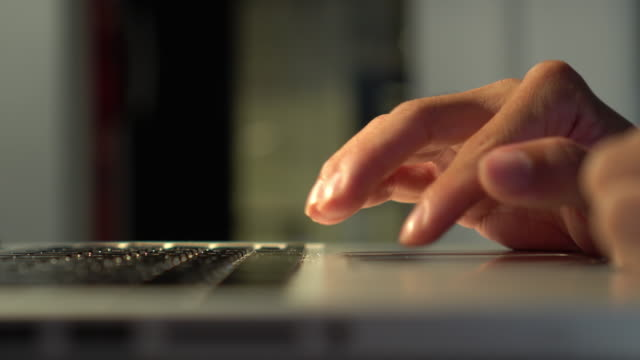 close up hand white collar office worker using computer laptop for working with warm light - touchpad stock videos & royalty-free footage