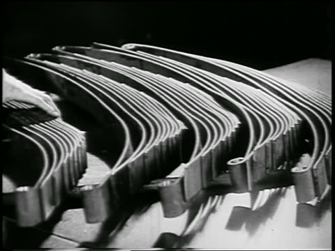 vidéos et rushes de b/w 1932 close up hand with metal parts in ford car factory / industrial - ford