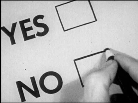 "B/W close up hand writing ""X"" with grease pencil in ""NO"" box on ballot"