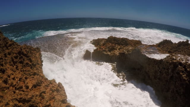 stockvideo's en b-roll-footage met close up handheld shot showing a blowhole on the coast, carnarvon, western australia, australia - spuitgat