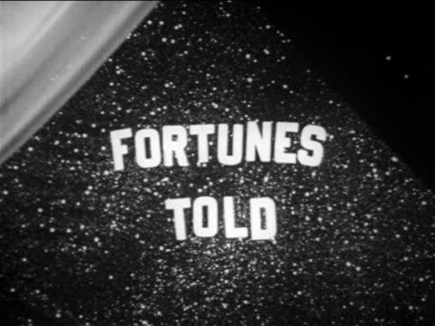 "vídeos de stock e filmes b-roll de b/w 1949 close up handmade ""fortunes told"" + starfield sign / educational - paranormal"