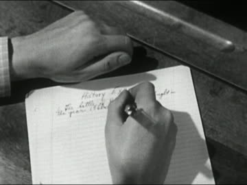 1950 close up hands and paper of boy taking history exam / opens left hand to reveal cheat sheet / audio - educational exam stock videos & royalty-free footage