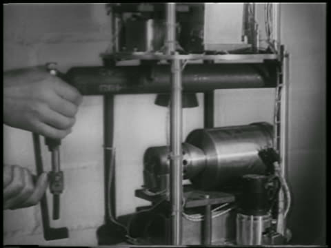 b/w 1952 close up hands inserting cannister of oxygen into rocket structure / white sands nm - 1952 stock videos & royalty-free footage