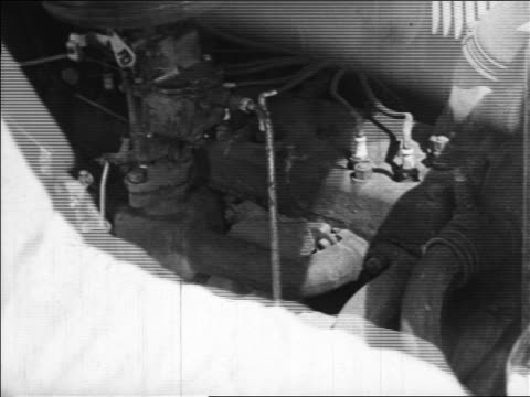 1938 close up hands of gas station attendant openning car hood revealing car internal combustion engine - gas station attendant stock videos and b-roll footage