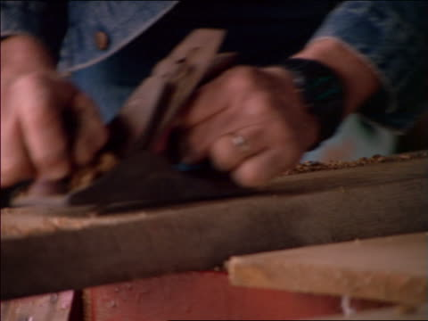 close up hands of man in denim jacket using hand lathe - denim jacket stock videos and b-roll footage