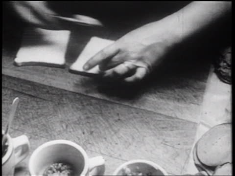 b/w 1939 close up hands of person making sandwich quickly / documentary - documentary footage stock videos & royalty-free footage