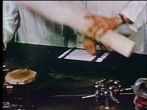 1947 close up hands of scientists in laboratory cutting stick of polystyrene with knife / educational - polystyrene stock videos & royalty-free footage