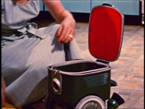 1950 close up hands of woman changing vacuum cleaner bags