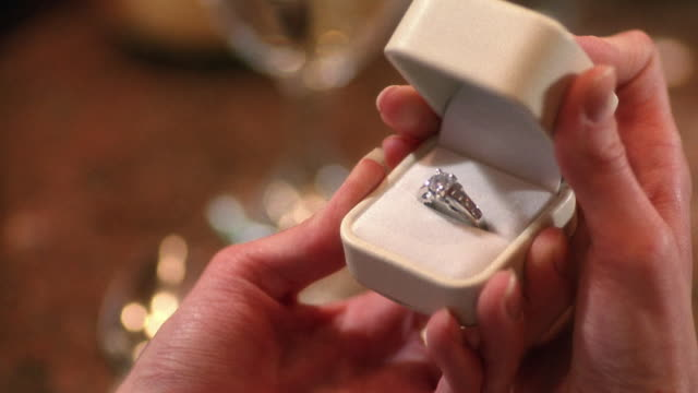 close up hands of woman opening jewel box with diamond ring inside - jewelry box stock videos and b-roll footage