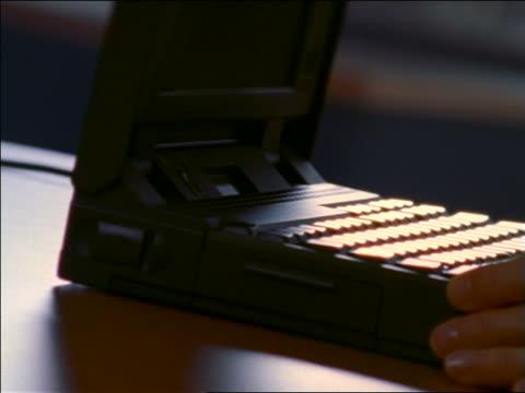 vídeos de stock e filmes b-roll de pan close up hands of woman opening, turning on + closing laptop computer - 1990 1999