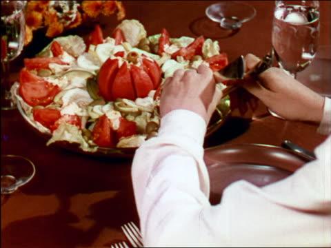 vídeos de stock e filmes b-roll de 1949 close up hands of woman serving salad / industrial - 1949