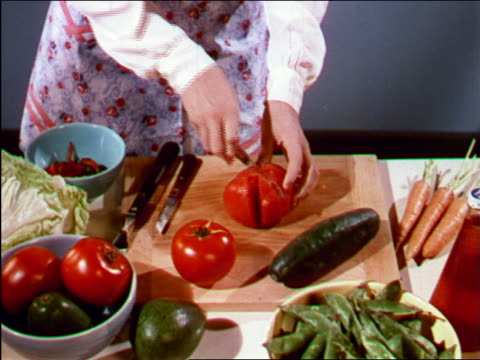1949 close up hands of woman slicing tomato / industrial - stay at home mother stock videos & royalty-free footage