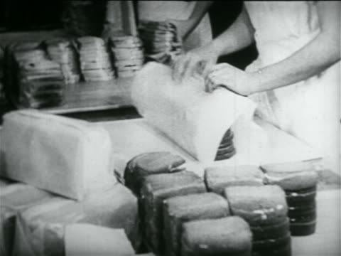 b/w 1934 close up hands of woman wrapping sandwiches in school lunch kitchen in wpa project / documentary - cafeteria worker stock videos and b-roll footage