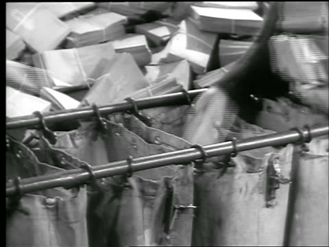 b/w 1944 close up hands of women sorting stacks of envelopes into large mail bags war bond office / ww ii - 1944 stock videos and b-roll footage