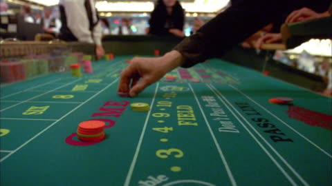 close up hands placing bets and rolling dice at casino craps table / las vegas - gambling stock videos & royalty-free footage