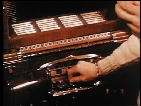 1945 close up hands pressing buttons on wurlitzer jukebox / industrial - jukebox stock videos & royalty-free footage