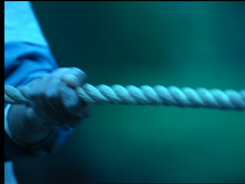 blue close up hands pulling rope in tug-of-war - rope stock videos & royalty-free footage