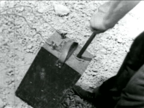 canted close up hands pushing plunger in wpa sewage construction project / documentary - explosive stock videos & royalty-free footage