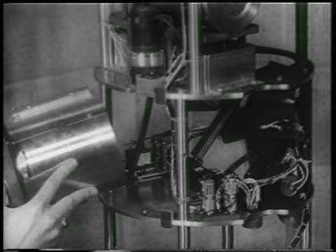 b/w 1952 close up hands putting cannister with mice astronauts onto rocket structure / white sands nm - 1952 stock videos & royalty-free footage