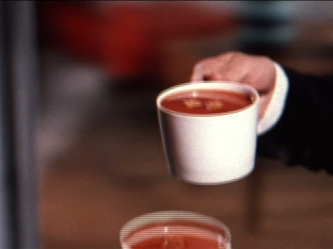 1962 close up hands toasting with cups of tomato soup / industrial - full stock videos & royalty-free footage