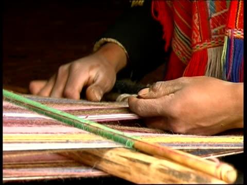 Close up hands weaving, Peru