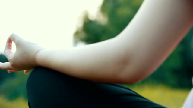 close up hands woman doing yoga in park - yoga stock videos & royalty-free footage