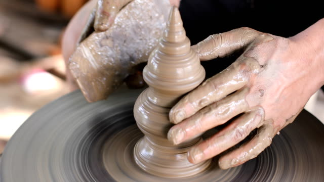 close up hands working on pottery wheel - potter stock videos and b-roll footage