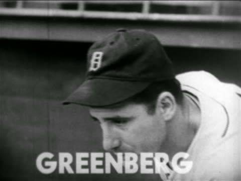 vídeos de stock e filmes b-roll de b/w 1938 close up hank greenberg in cap looking down chewing gum / detroit tigers - camisola de basebol