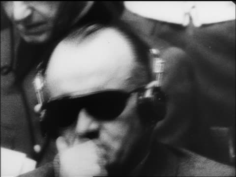 B/W 1945/46 close up Hans Frank with eyeglasses headphones at war crime trials / Nuremberg / documentary